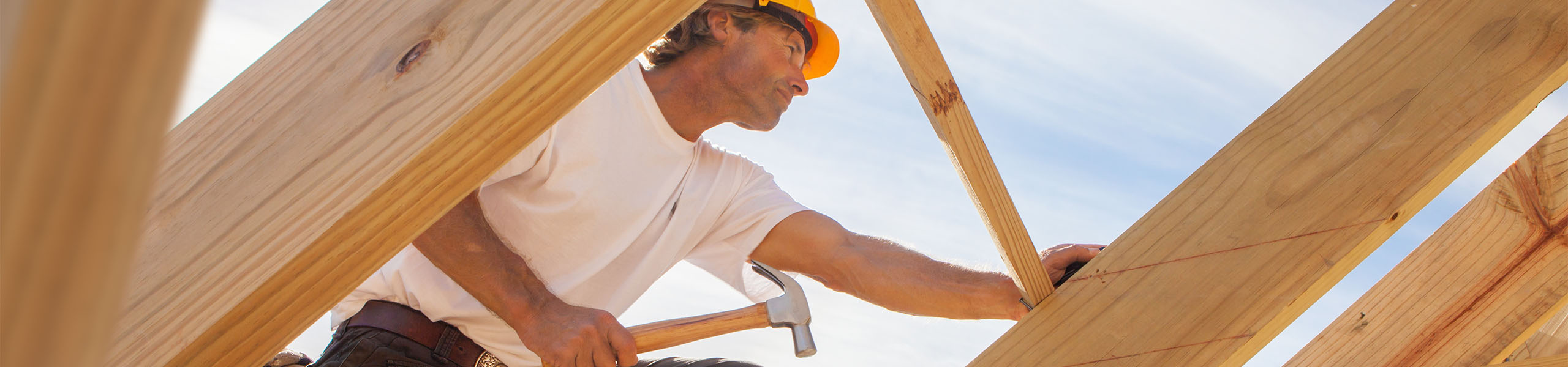 http://Man%20working%20on%20construction%20site