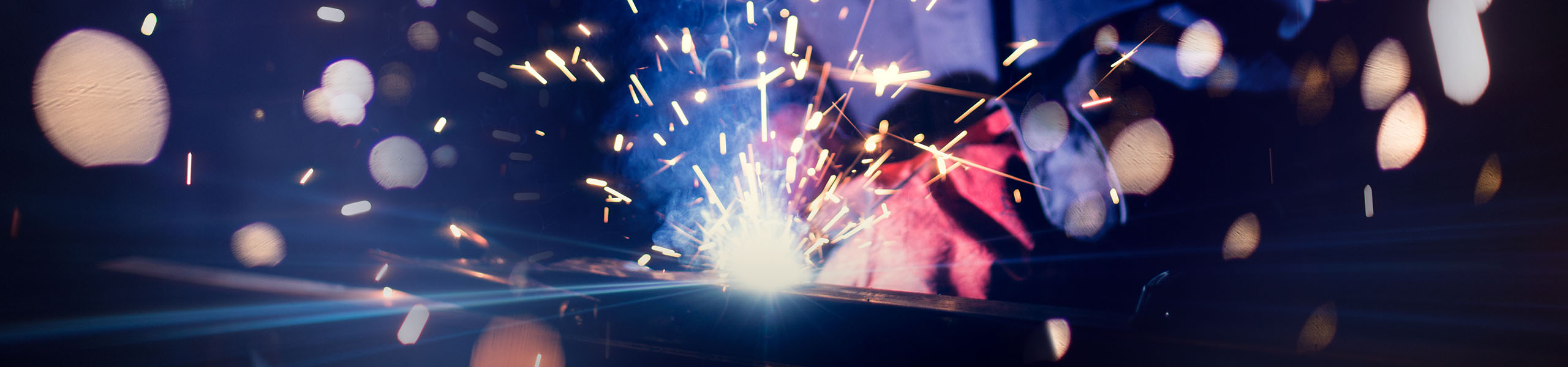 http://Blurred%20Sparks%20from%20welding
